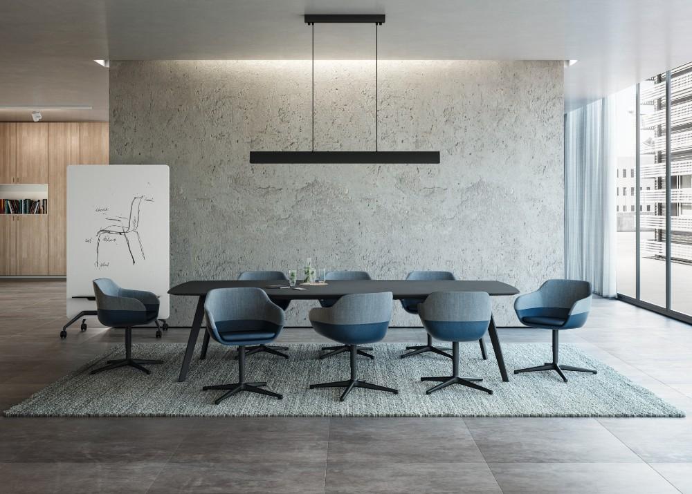 Maximale Vielfalt in Farbe, Form und Material. Besonders raffiniert wirkt der crona Clubsessel mit einem zweifarbigen Polster. Abbildung: Brunner GmbH